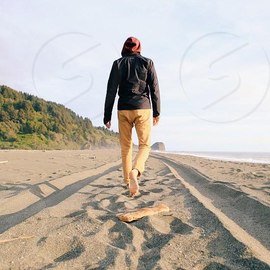 Adventure travel man beach coast Pacific Northwest  photo