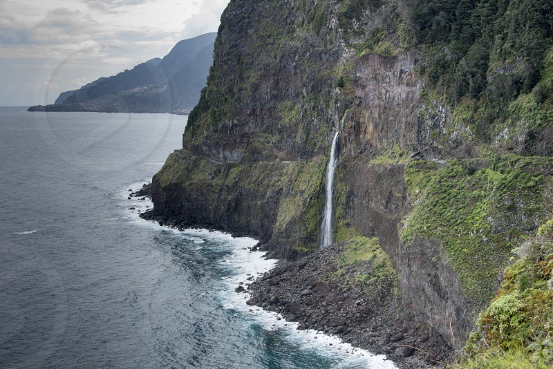 Wild atlantic coast Island Madeira coastline - impressiv mountain with waterfall - Ponta do Poiso photo