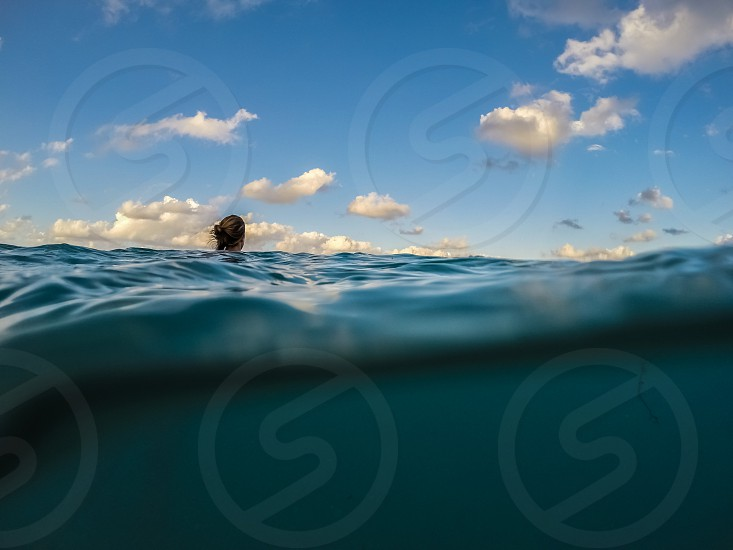 lone swimmer above water under water photo
