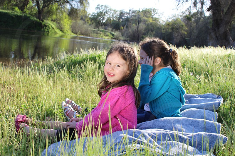 Girls sisters river outdoors sitting smile children daisyevelynphotography daisynolasco photo