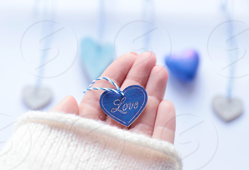 Blue wooden heart in the hand  photo