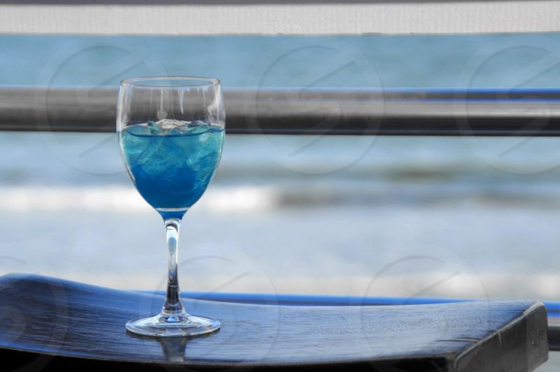 Enjoying a cocktail on a beach house balcony in North Carolina photo