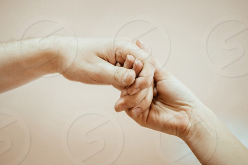 A firm handshake woven fingers man and women hands photo