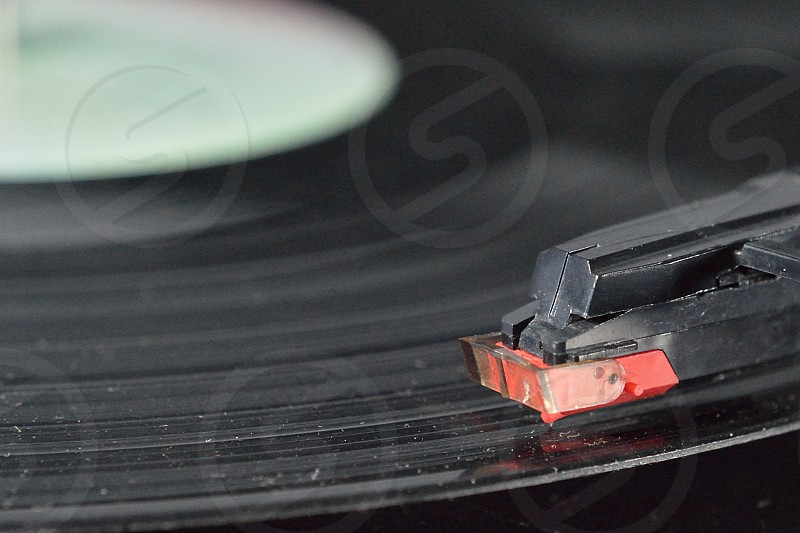 selective focus photography of black and red vinyl player pin photo