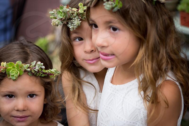 3 girls in white tank dress wearing green succulent headband photo