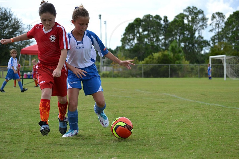 girls playing soccer photo
