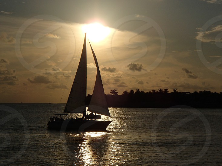 sailboat on sea under white sky during daytime photo