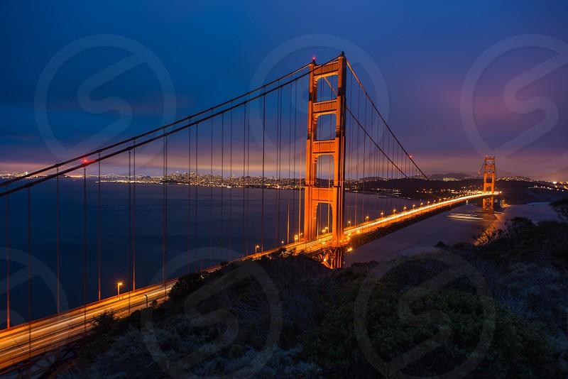 Golden Gate Bridge sundown blue hour long exposure light trails photo