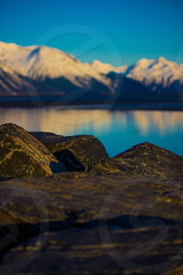 Reflections on the water in the Cook Inlet along the Seward Highway in Alaska photo