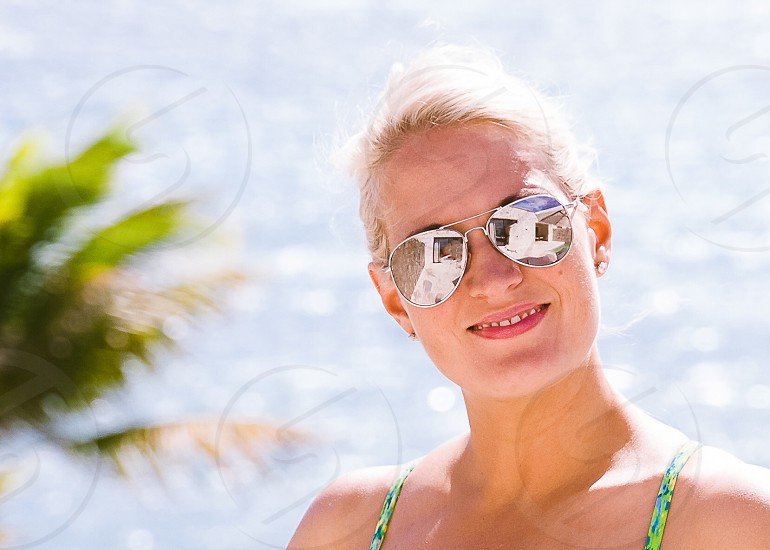 Woman in sunglasses on beach in summer photo