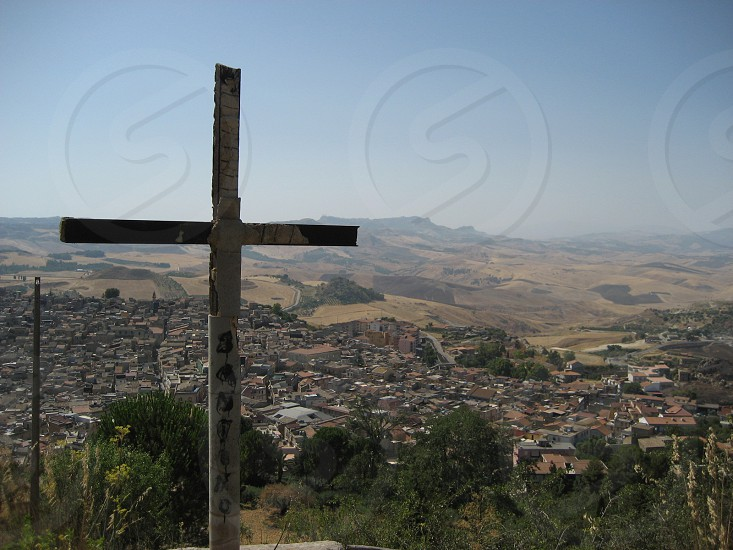 brown wooden cross on mountain photo