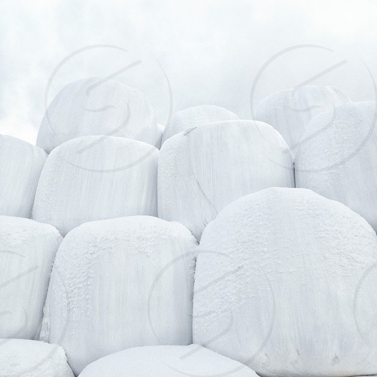 stacked cylindrical white ice columns photo