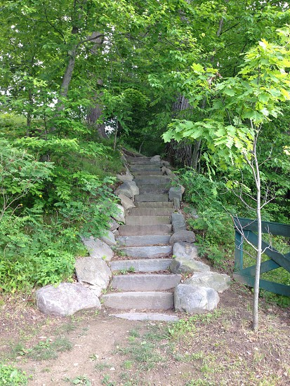 A stone stairway ascending over a hill in an upstate New York park. photo