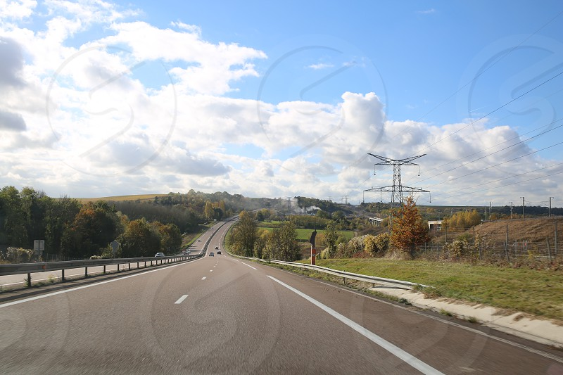 Highway in France at sunny and cloudy day photo