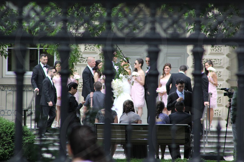 Wedding bride groom perspective street wedding party photo