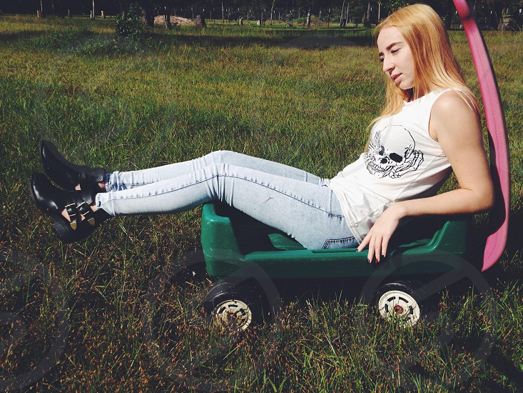 woman in white tank top sitting on cart photo