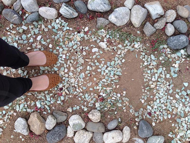 woman standing in between stones photo