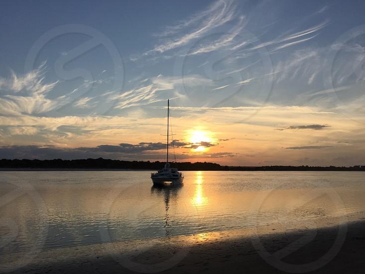 Sailing boat sunset Matanzas Inlet Florida nautical  photo