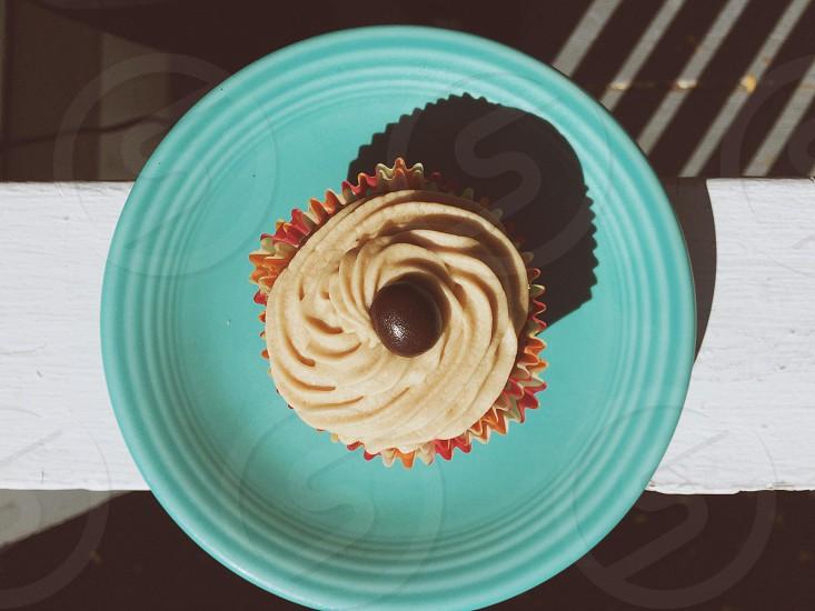 Espresso buttercream and chocolate cupcake.  photo