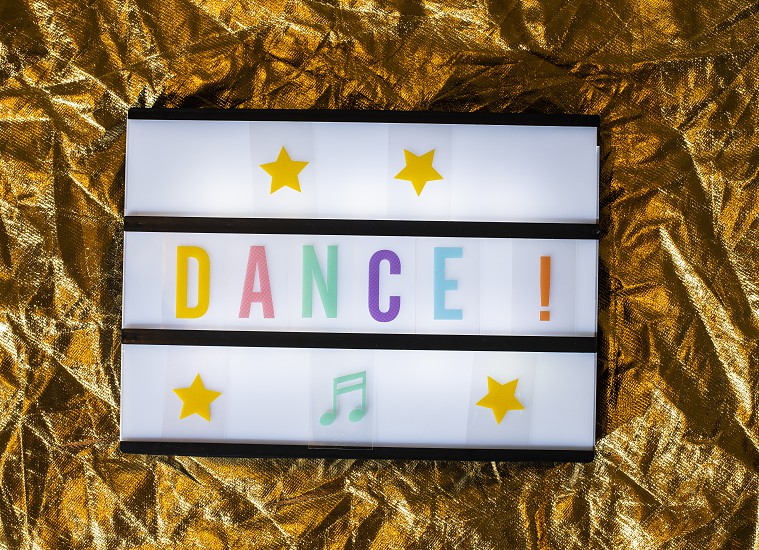 Text Dance on white illuminated board. Conceptual message for entertainment. Announcement concept. photo