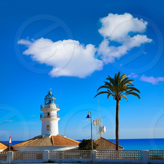 Cullera Lighthouse in Valencia at Mediterranean sea of Spain photo