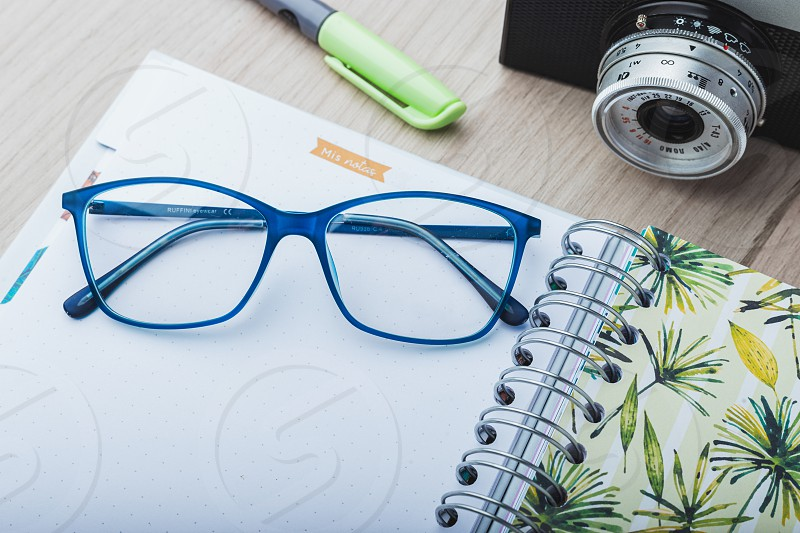 Woman glasses with planner and camera photo
