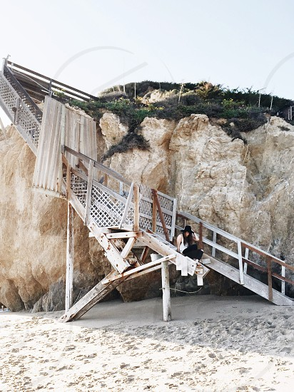 Beach Sunset golden hour sand dock stairs female model ocean California young college spring break photo
