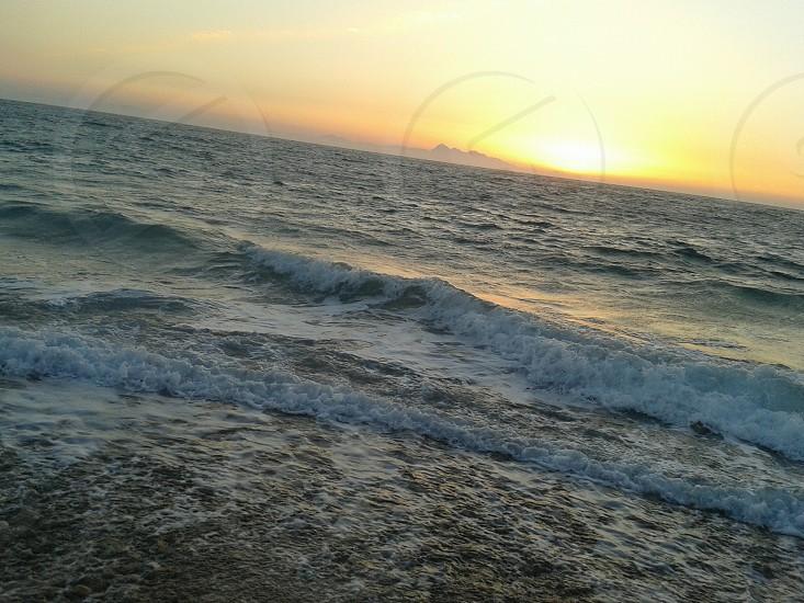 sundown in the sea photo