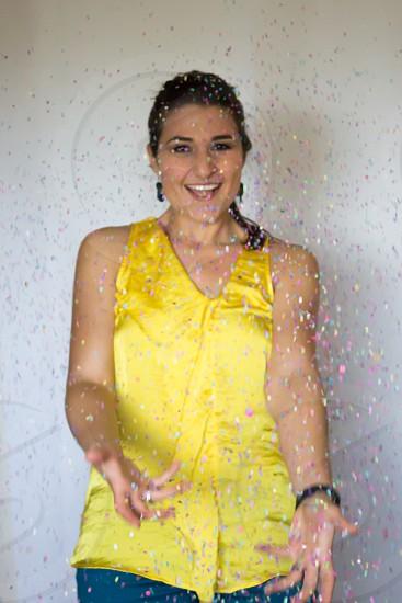 Hispanic woman with confetti falling photo