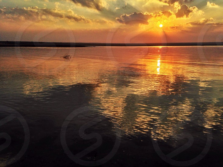 Sunrise lake reflection mirror sky orange sun Qaroon Fayoum egypt photo