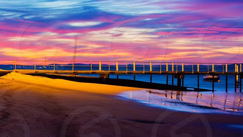 Sunrise pier beach early mornings colour colourful  photo