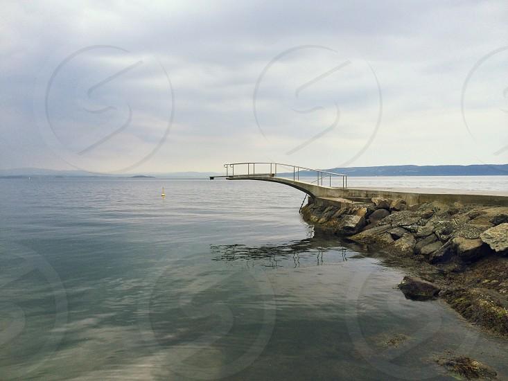 walkway on rocks over water photo