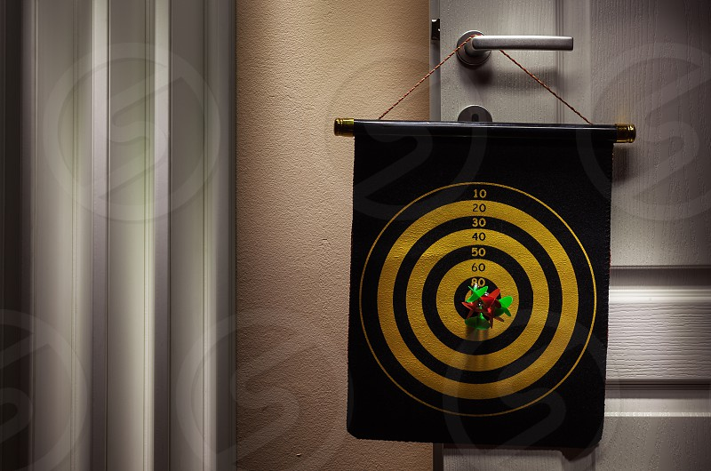 Details of dartboard hanged on room door hobby and recreation at home.  photo