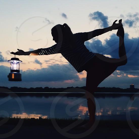 woman holding lantern photo