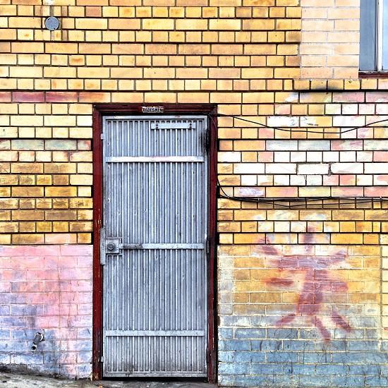 grey and brown wooden door on bricks photo