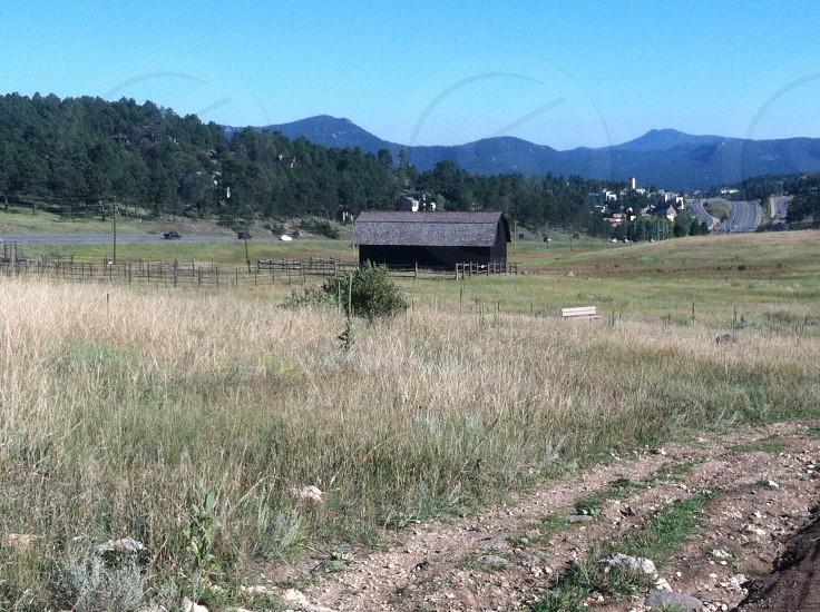 Barn in a field photo