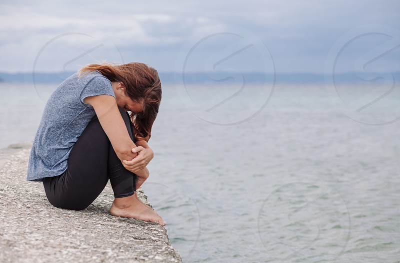 Woman alone and depressed on the bridge photo