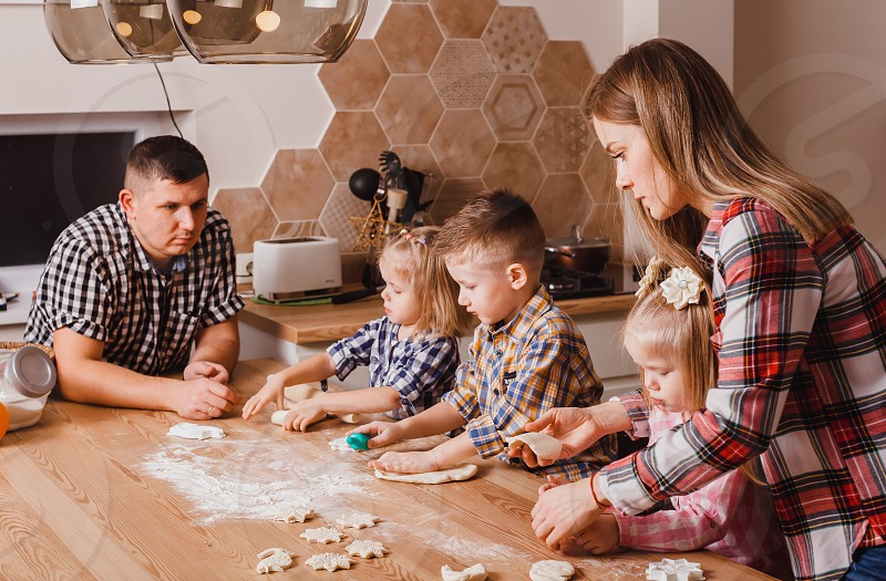 Big happy family preparing with love cookies at home on the kitchen  photo