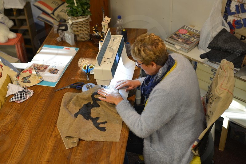 Woman with sewing machine making creative things  photo