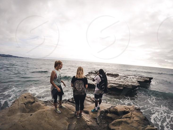 Travel rocks California ocean family photo