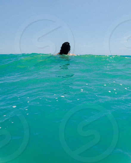 Swimming ocean sea blue green swim water waves vacation travel  photo