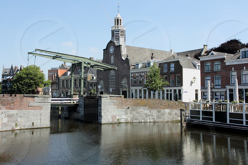 Rotterdam old  drawbridge and church in the historic district. photo
