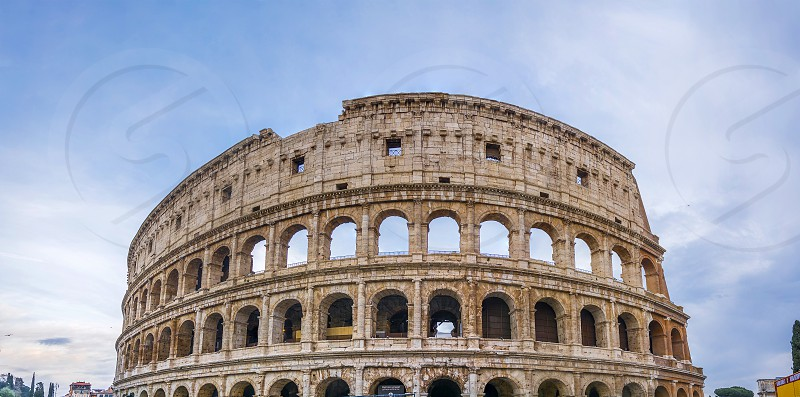 The Colosseum or Coliseum also known as the Flavian Amphitheatre is an oval amphitheatre in the centre of the city of Rome Italy. Built of concrete and sand it is the largest amphitheatre ever built. photo