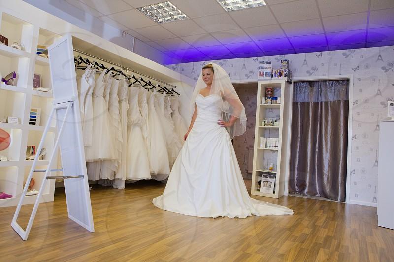 woman wearing wedding dress standing photo