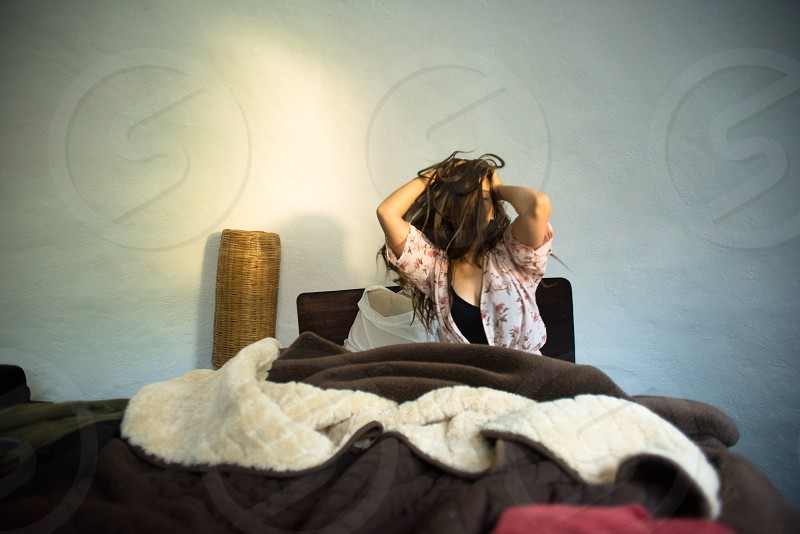 Young woman waking up in a good and wild mood photo