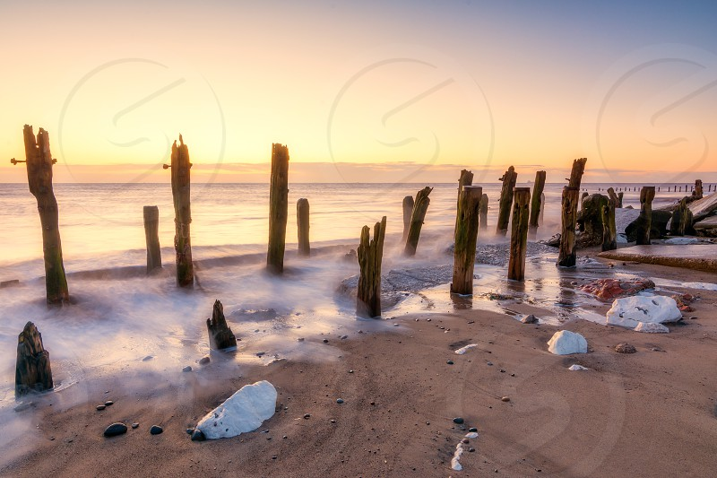 Old eroded sea defenses at the Yorkshire nature reserve of Spurn point photo