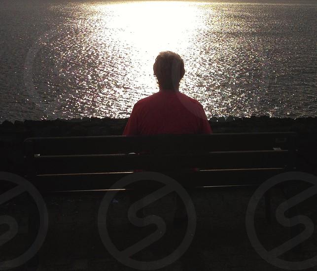 Meditation male bench sea sun photo
