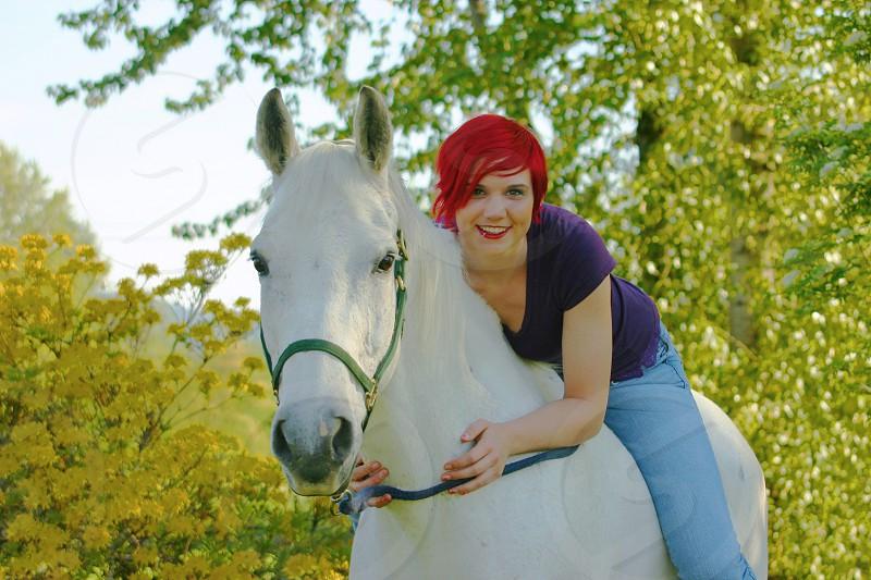 Girl on horse photo
