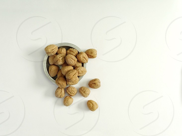 walnuts nuts white background from above healthy eating health wellbeining diet bowl food fall food  photo