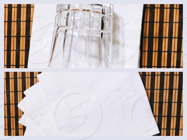 clear round base rock glass on white table napkin photo